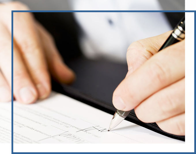 Businessman signing agreement | Business Formation Operational Document Attorneys of GADC Law