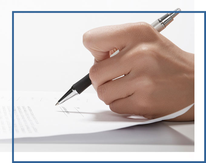 Hand Signing Agreement | Contract Negotiation & Preparation Attorneys GADC Law