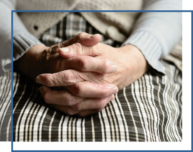 Older Woman's hands folded in her lap | Nursing Home Negligence Attorneys GADC Law