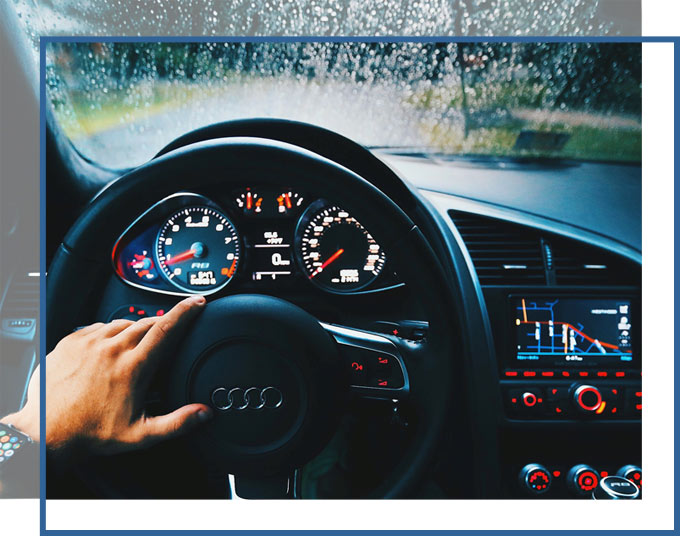 Driver at wheel of a car on a rainy day | Personal Injury Car Accident Attorneys of GADC Law