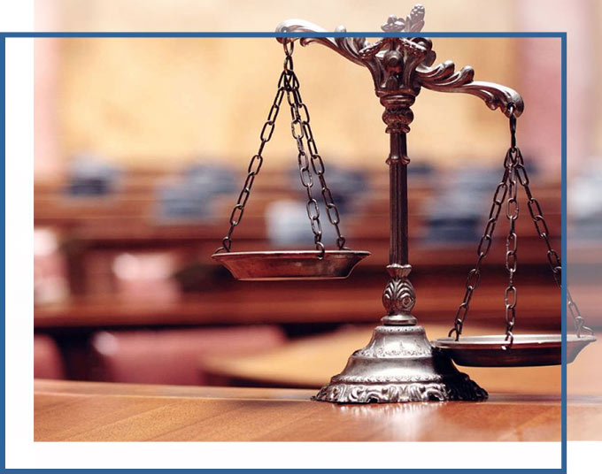 Scales of Justice sitting on the table of a courtroom | Trust & Estate Litigation Lawyers GADC Law